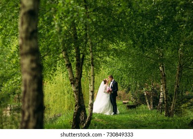 Beautiful couple walking in the park in their wedding day