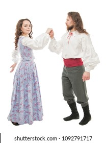 Beautiful couple woman and man in medieval clothes dancing  isolated