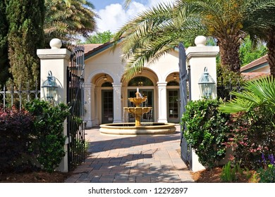 A beautiful courtyard with fountain in front of South Carolina home.