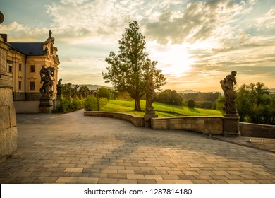 BEAUTIFUL COURTYARD WITH UNIQUE BAROQUE SCULPTURES AND PARK GARDEN AT KUKS CASTLE IN SUN SET LIGHT, OLD FAMOUS HOSPITAL IN CZECH REPUBLIC