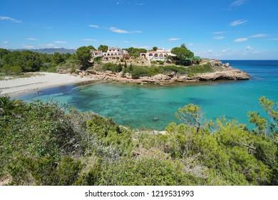 A beautiful cove with houses on the Mediterranean coast of Spain near L'Ametlla de Mar, Costa Dorada, Cala Estany Tort, Catalonia, Tarragona province