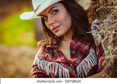 beautiful cowgirl style closeup model model on farmland