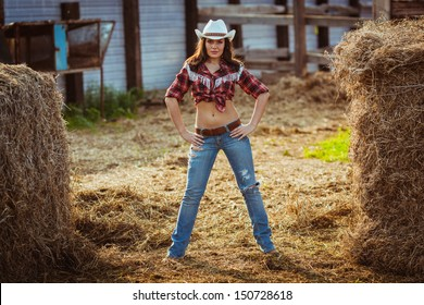 beautiful cowgirl style model posing on farmland