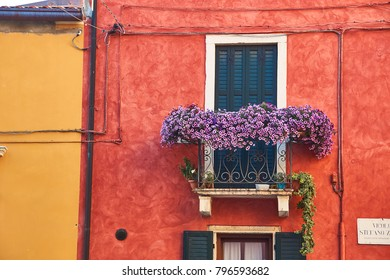 Beautiful cozy buildings with balconies in Soave, Italy