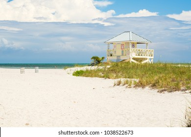 Beautiful Crandon Park Beach in Key Biscayne in Miami on a windy day with grassy dunes and lifeguard station.
