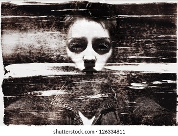 Beautiful but creepy woman's black eyed face, showing negative emotion, in grungy vintage style