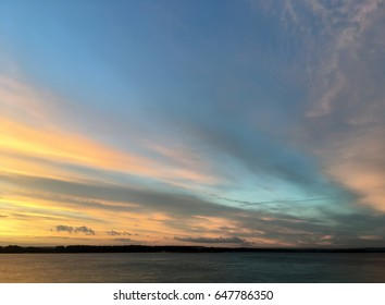 Beautiful crimson orange sunset on the river Volga in the city Samara in Russia