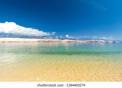 Beautiful croatian beach on sunny summer day and blue water