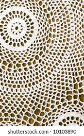 Beautiful crochet tablecloth for background.