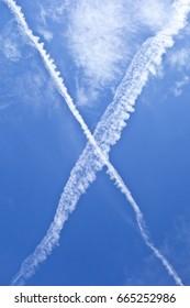 Beautiful Cross Shape Summer Clouds and Blue Sky