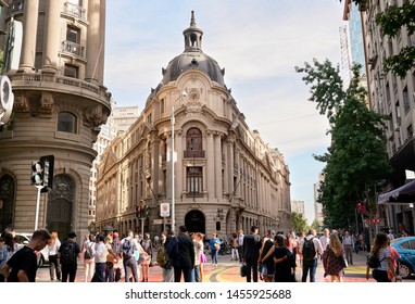 Beautiful crowded Santiago metropolitan main area Paseo Ahumada and Paseo Bandera street full of famous one day trips and landmarks to visit in Chilean Capital. Santiago, Chile, March, 2019.