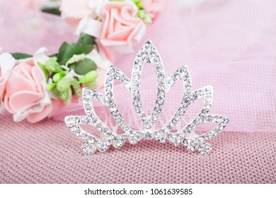 Beautiful crown for a child on a pink background