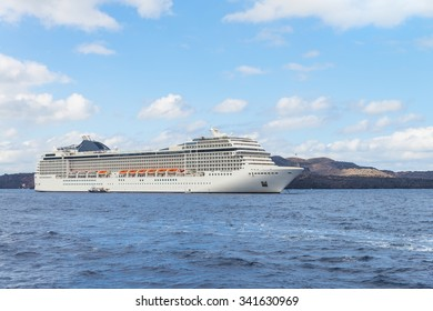 Beautiful cruise liner at harbour next to volcano.Santorini (Thira) island.Cyclades.Greece.Europe.