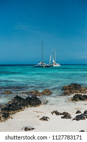 Beautiful crystal clear beach with catamaran at the background