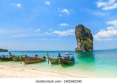 Beautiful crystal clear turquoise blue sea and boats at Ko Poda Island, Ao Phra Nang bay, Krabi, Thailand