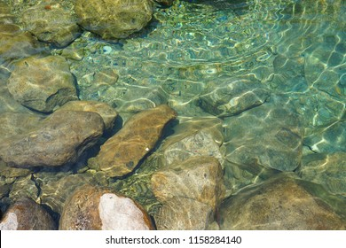 Beautiful crystal clear water spring for swimming with rocks and mountain