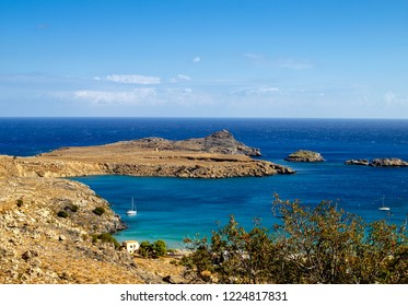 The beautiful crystal clear waters of Lindos Bay, situated directly opposite the town of Lindos, Rhodes, Greece.