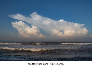 Beautiful Cumulonimbus clouds at the beach. Cumulonimbus (from L