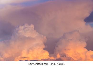 Beautiful cumulus cloudscape at sunset.  Cloudy summer weather nature background.