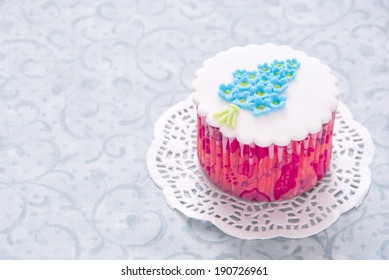 Beautiful cupcake with sugar flower Forget-me-not