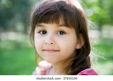 Beautiful curious girl  in a summer park