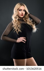 Beautiful Curly Hair. Smiling Girl With Healthy Wavy Long Blonde Hair. Portrait Happy Woman With Beauty Face, Sexy Makeup And Perfect Hair Curls. Volume, Hairstyle, Hairdressing Concept.