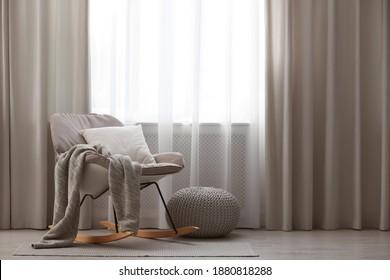Beautiful curtains on window in stylish room interior