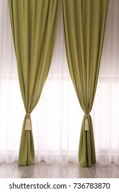 Beautiful curtains with tiebacks indoors