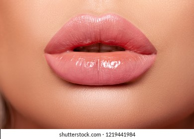 Beautiful curvy feminine lips with nude lipstick. Large Volumetric Lips, mouth open, puffy lips, glossy lipstick glaze
