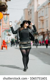 Beautiful curvy, overweight girls in black dress.Happy and smiling plus size, chubby, curvy girl.
