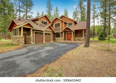 Beautiful custom made home exterior accented with mixed wood and stone siding. Northwest, USA