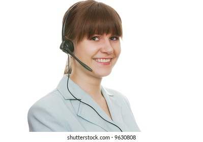 Beautiful customer support agent with headset smiling during a telephone conversation