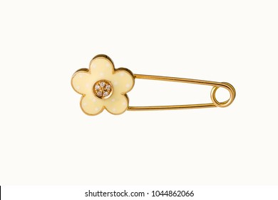 Beautiful Cute Baby & Kid safety Pin Brooch Jewelry with the safety pin design features a classic closure decorated throughout in yellow gold and diamond, birthday baby gift isolated on white