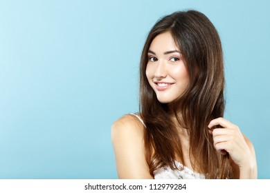 beautiful cute fresh happy smiling teen girl portrait over blue background