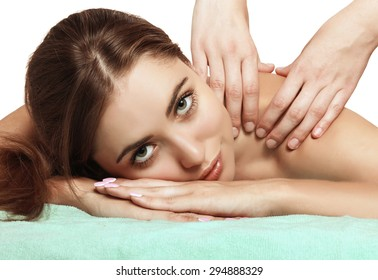 Beautiful and cute girl with green eyes on the back massage