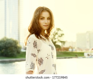 Beautiful cute girl on a sunny day walking in the park