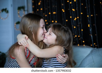 Beautiful cute  girls  posing on bed  at home