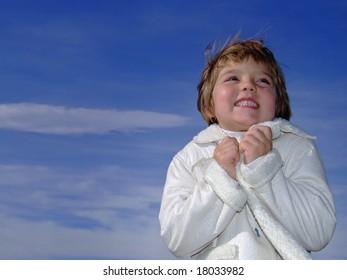 beautiful cute little  girl freezing outdoor