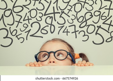 beautiful cute little girl with handwritten numbers above her head