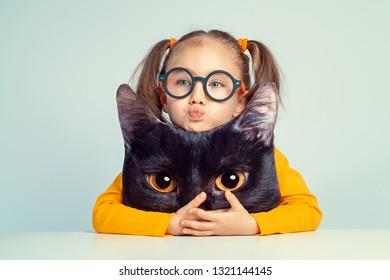 beautiful cute little girl hugging to cat shaped pillow