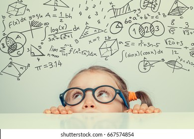 Beautiful Cute Little Girl With Math Formulas And Problems