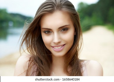 Beautiful cute smiling woman outdoor portrait