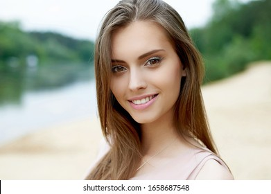 Beautiful cute smiling woman outdoor portrait