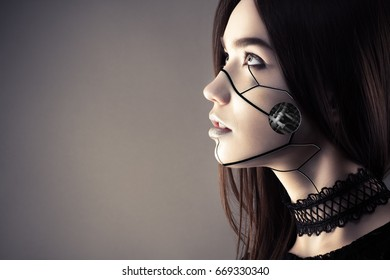 beautiful cyberpunk girl with fashion makeup looking up