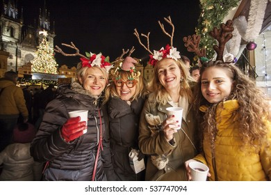 Beautiful Czech Girls having fun at Old town square Christmas market in Prague, Czech republic, Dec 3, 2016, Illustrative Editorial