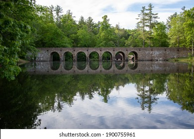 Beautiful dam at Cumberland Mountain State Park holding back Byrd Lake with a reflection on the smooth surface of the water.