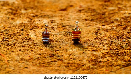 Beautiful damaged small lights bulb on a yellowish soil surface unique photo