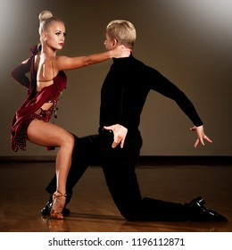 Beautiful dance couple dance in ballroom, passionate rumba