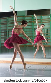 beautiful dancer ballerina is doing exercises in ballet class