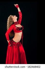 Beautiful  dancer in eastern costume on black background